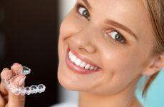 Капы для исправления прикуса зубов. Принцип действия, особенности использования и ухода